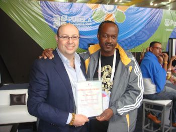 Master Michael Sirota receiving a Certificate of Appreciation from the Mr. Ronald Philip - President - Barbados Taekwondo Association