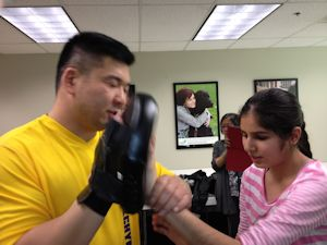 Instructor working with a visually impaired girl @ Canadian National Institute for the Blind.